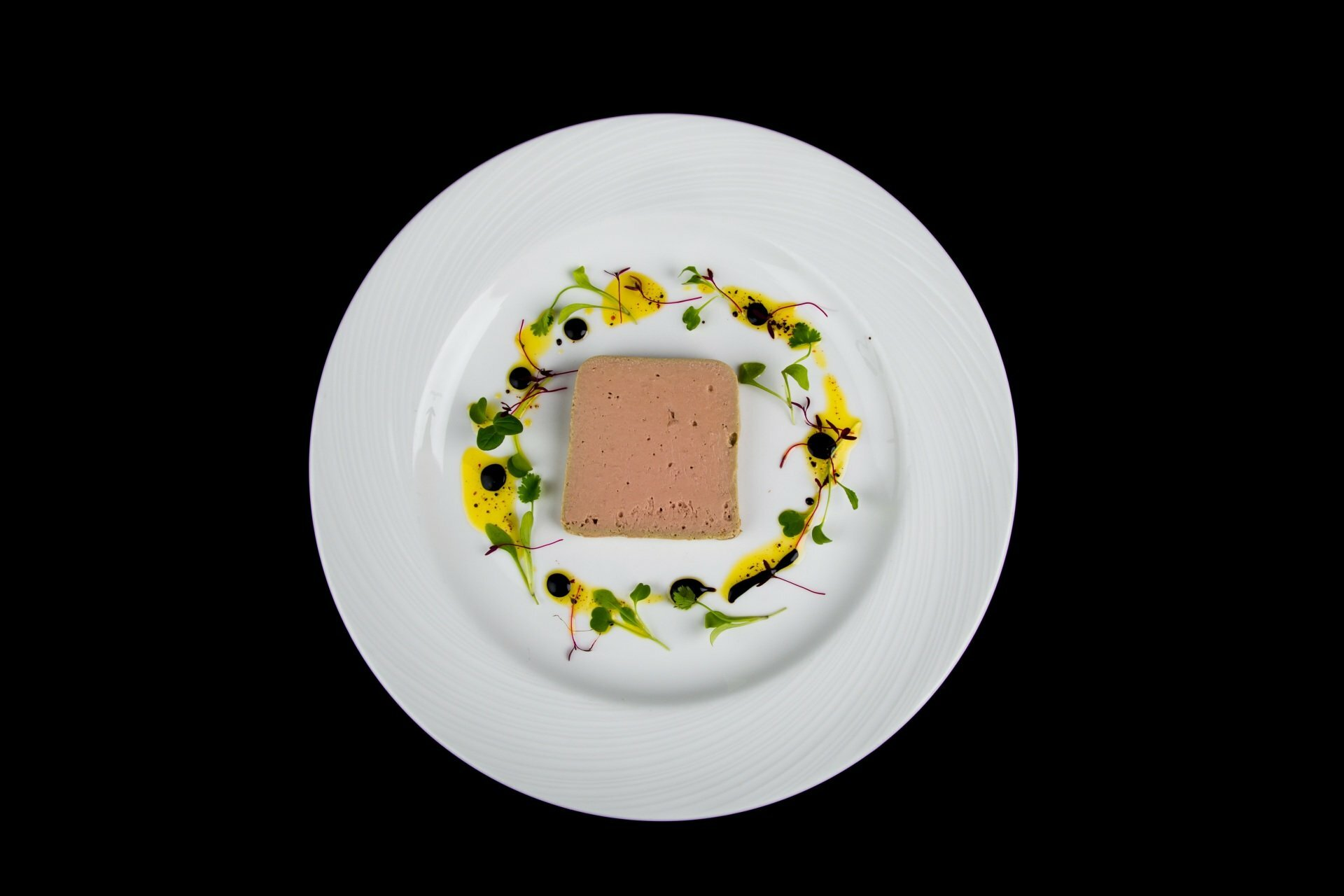 CHICKEN LIVER PARFAIT ON PLATE WITH DRESSING