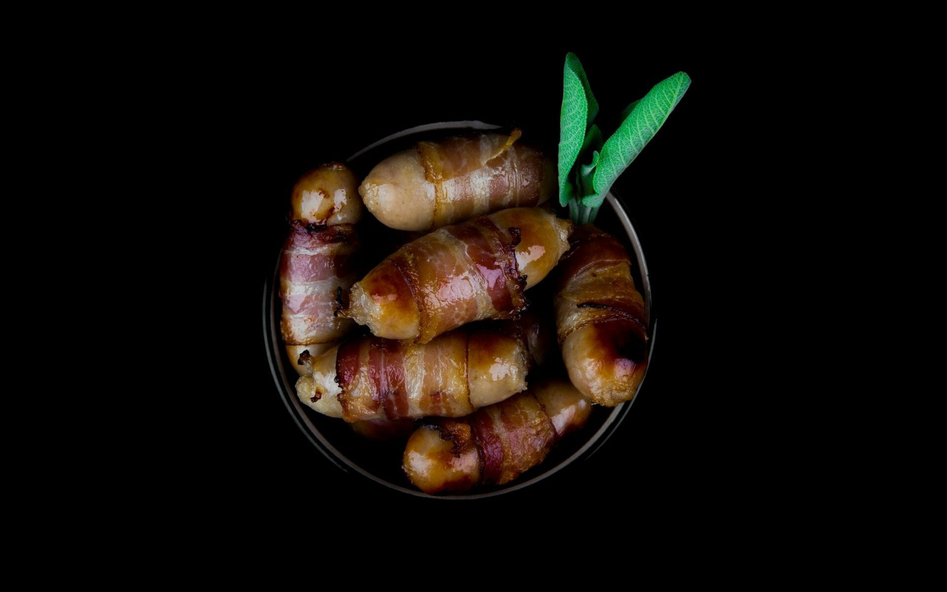 Plate of Chipolatas Wrapped in Streaky Bacon