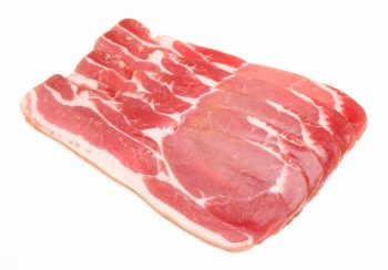 6 rasher of uncooked bacon on white table