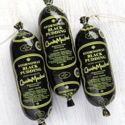 3 sleeves of Charles Macleod Stornoway Black Pudding on grey wood table