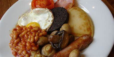 BREAKFAST PLATE WITH SAUSAGE, BLACK PUDDING, EGG, MUSHROOM BACON, TOMATO, POTATO SCONE